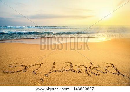 Word Sri Lanka written on a tropical beach sunset