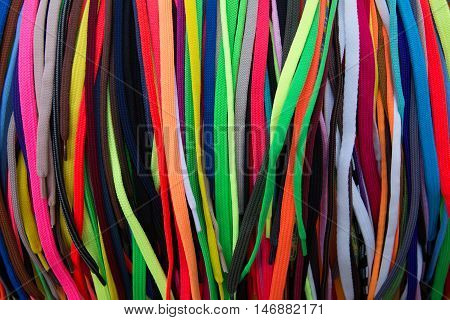 Numerous non sorted colorful shoe laces in batch