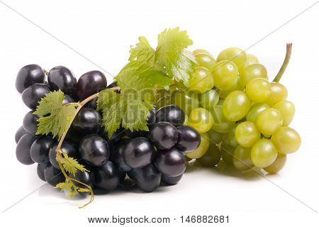 a bunch of green and blue grape with leaves isolated on white background