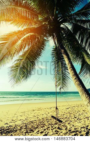 Vintage landscape nature background, Coconut palm tree with sand beach and blue sea in blue sky background