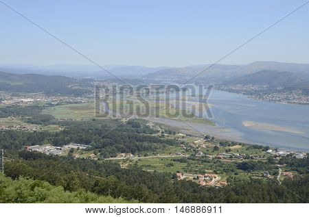 Minho estuary at the Atlantic Ocean beteween the Galician and Portuguese coast seen from Mount of Santa Tecla in Spain.