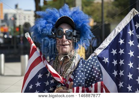 BRONX NEW YORK - SEPTEMBER 4: Lenny Lipschitz wears American flags before game at Yankee Stadium Taken September 4 2015 in New York.