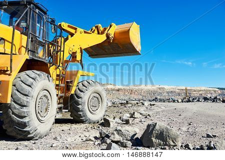 wheel loader excavator at granite or iron ore opencast mine