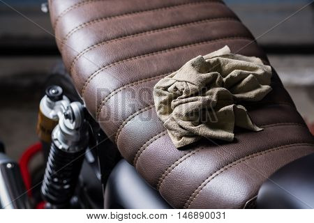 Motorcycles detailing series : Chamois cloth on vintage motorcycle seat