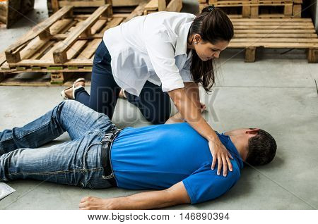 girl assisting an unconscious man after fatal accident