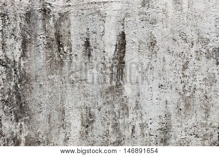The grunge cracked old concrete texture wall