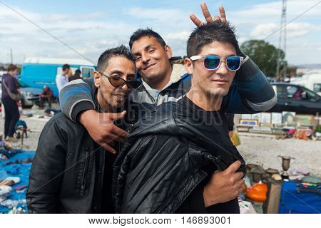 ZAGREB, CROATIA - OCTOBER 20, 2013: Roma salesmen posing for camera at Zagreb's flea market Hrelic.