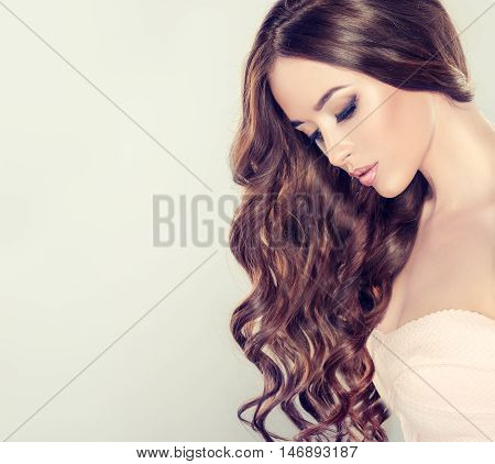 Beautiful girl light brown hair with an elegant hairstyle , hair wave ,curly hairstyle