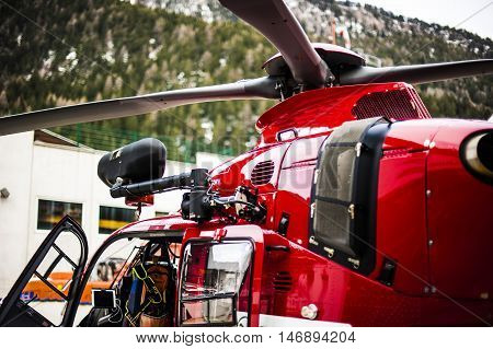 rescue helicopter in the mountains after fatal accident