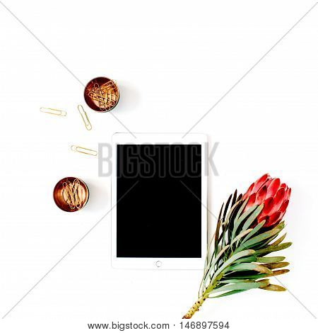 beautiful proteus flower tablet and golden clips isolated on white background. flat lay top view