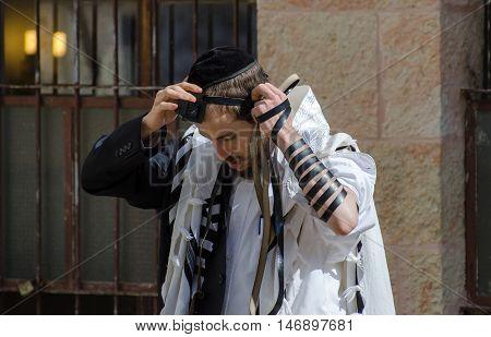 JERUSALEM ISRAEL - MARCH 30 2012: Orthodox Jewish man pray in jewish quarter. Jerusalem. Israel