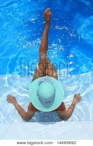 young woman sitting in a swimming pool
