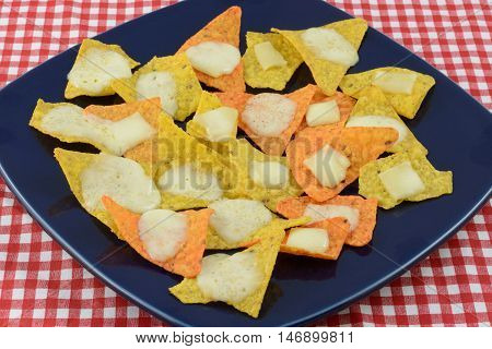 Nachos with tortilla chips and mozzarella cheese on plate