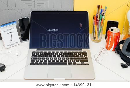 PARIS FRANCE - SEP 8 2016: Apple Computers website on MacBook Retina in room environment showcasing live coverage of Apple Keynote - Tim Cook about Education programm