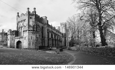 Kilkenny Castle and gardens in autumn with heavy clouds. It is one of the most visited tourist sites in Ireland. Black and white