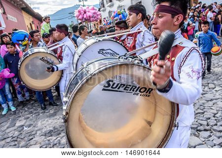 Antigua Guatemala - September 15 2015: Drummers march in street parade during Guatemalan Independence Day celebrations