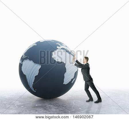 Businessman pushing abstract terrestrial globe on light background. Global business concept. 3D Rendering