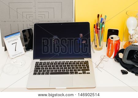 PARIS FRANCE - SEP 8 2016: Apple Computers website on MacBook Retina in room environment showcasing live coverage of Apple Keynote - Apple COO Jeff Williams about new Apple Watch Activity app
