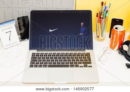 PARIS FRANCE - SEP 8 2016: Apple Computers website on MacBook Retina in room environment showcasing live coverage of Apple Keynote - presenting the new Apple Watch Nike edition