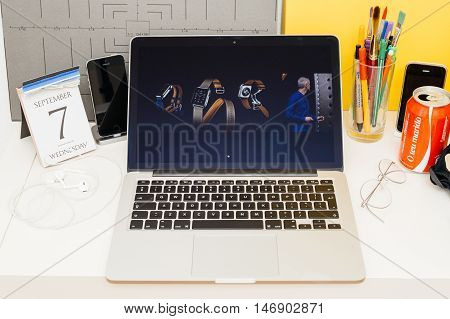 PARIS FRANCE - SEP 8 2016: Apple Computers website on MacBook Retina in room environment showcasing live coverage of Apple Keynote - apple watch and hermes luxury collaboration leather strap