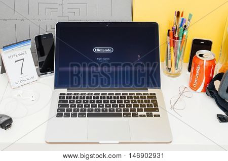 PARIS FRANCE - SEP 8 2016: Apple Computers website on MacBook Retina in room environment showcasing live coverage of Apple Keynote - Super Mario is coming to App Store