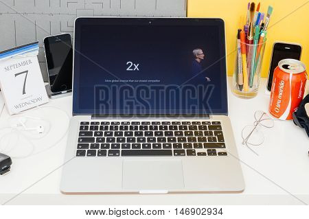 PARIS FRANCE - SEP 8 2016: Apple Computers website on MacBook Retina in room environment showcasing live coverage of Apple Keynote - Tim Cook talking about cometition with Google App Store