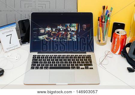 PARIS FRANCE - SEP 8 2016: Apple Computers website on MacBook Retina in room environment showcasing live coverage of Apple Keynote -