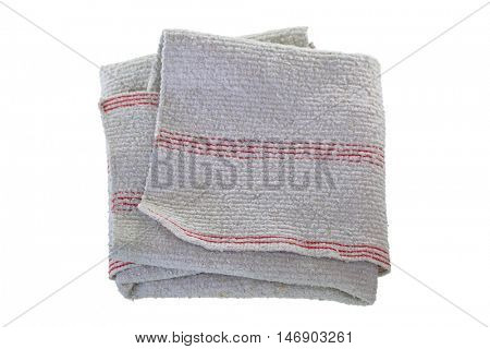Folded used and dirty grey rag for cleaning purpose isolated on white background