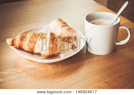 Cappuccino With Croissant. White Cup Of Coffee