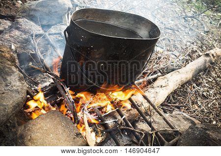 Old Sooty Black Pan On A Bonfire