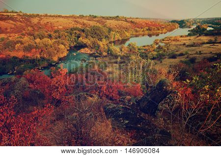 Rural autumn beautiful landscape with river and colorful trees, seasonal background