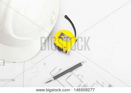 Construction Helmet With Pencil And Measure Tape Near It