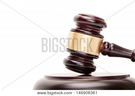 Close up of wooden judge gavel and soundboard on white background