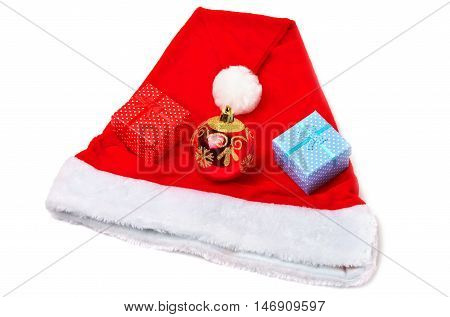 Santa Claus red and white hat toy bubble and christmas gifts on white background.