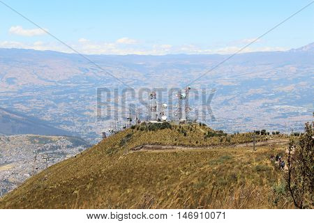 This photo shows a beautiful valley in the background and the cableway station on top of the mountain at Quito, Ecuador.