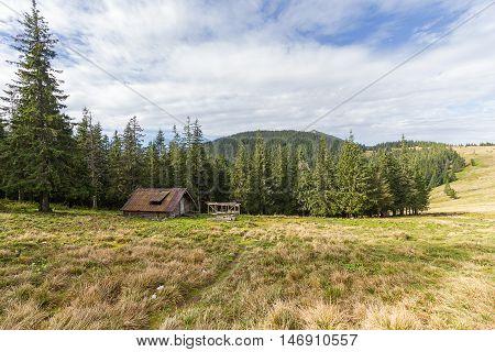Hut of the shepherd on the mountain plain. Carpathians
