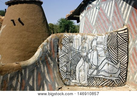 African family compound with granary and building and painted designs on the mud walls