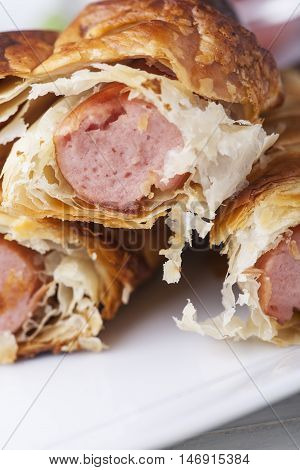 closeup of frankfurter sausages in puff pastry
