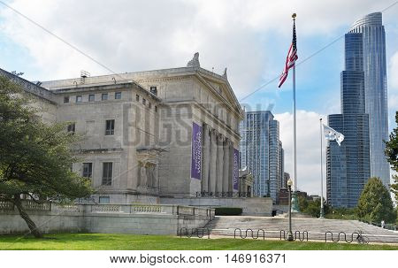 CHICAGO, ILLINOIS - SEPTEMBER 5, 2016: Field Museum. The Flag of Chicago and the American Flag with city in the background.