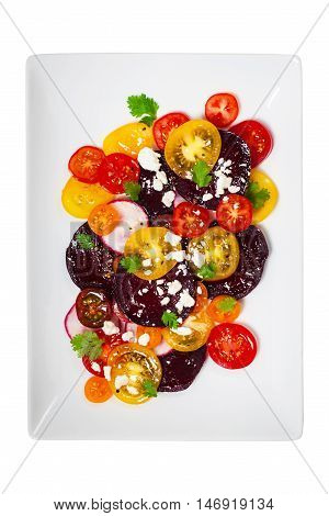 Tomato Beet Salad with Feta Isolated on white. Selective focus.
