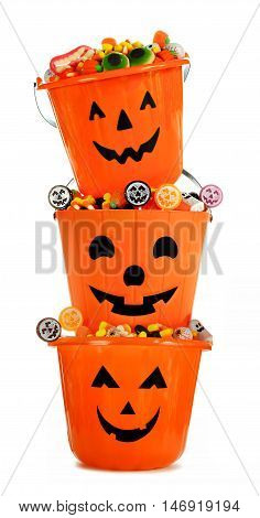 Halloween Jack O Lantern Candy Holders Stacked And Filled Over A White Background