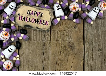 Happy Halloween Tag With Candy Top Corner Border Against An Aged Wood Background
