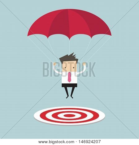 Businessman with parachute focused on a target