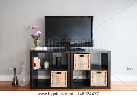 TV blank screen on buffet in modern living room