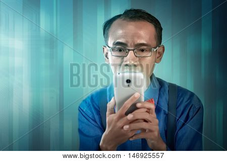Nerdy Man Holding Cellphone
