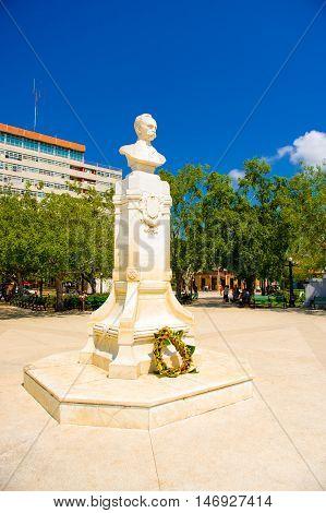 CIEGO DE AVILA, CUBA - SEPTEMBER 5, 2015: Main plaza square with statue, Downtown of Ciego de Avila. The city has a population of about 86, 100.