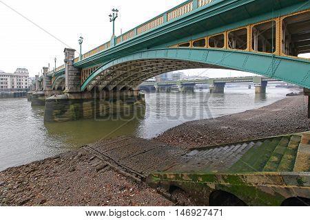 Southwark Bridge Over Low Tide River Thames in London