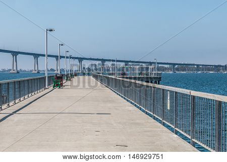 Cesar Chavez Park pier with Coronado Bridge in San Diego, California