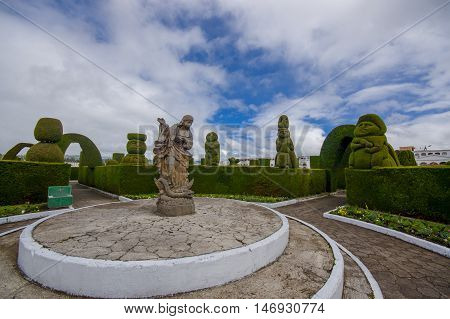 TULCAN, ECUADOR - JULY 3, 2016: statue of an angel standing over a snake in the denter of the cemetery.