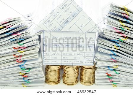 House On Pile Of Gold Coins Between Dual Pile Overload